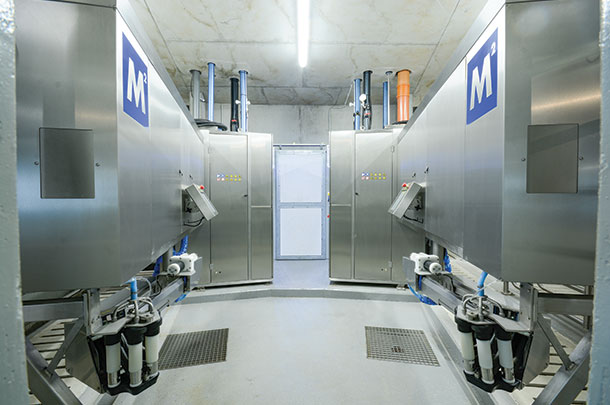 Robot rooms positioned around the holding area allow access to two of the robots.