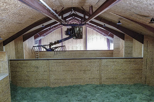 The drying system includes a hay crane to distribute hay among the boxes